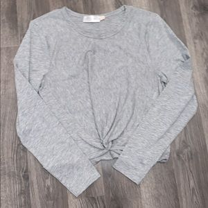 Long sleeve, cropped, gray shirt.
